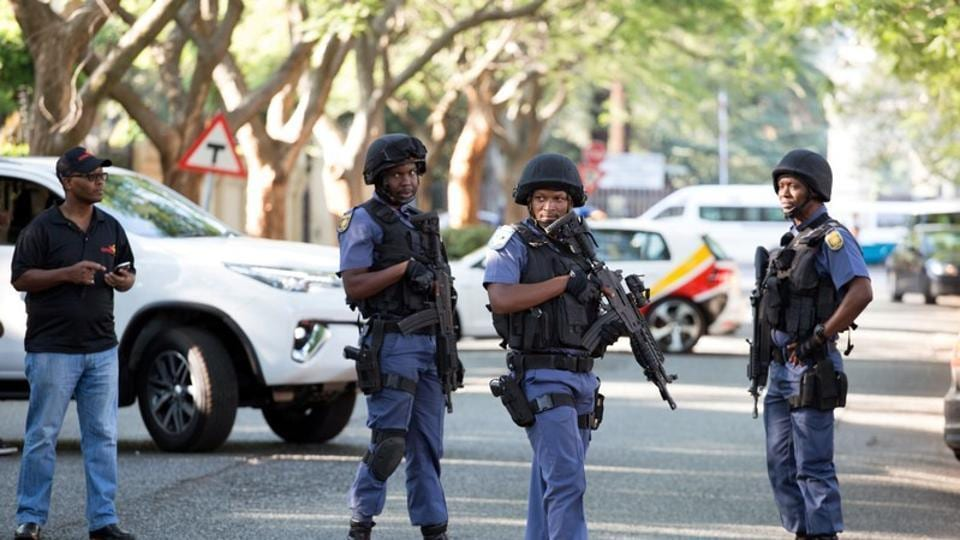 Police close off roads around the house of the Gupta family, friends of President Jacob Zuma, in Johannesburg, South Africa, on Wednesday.