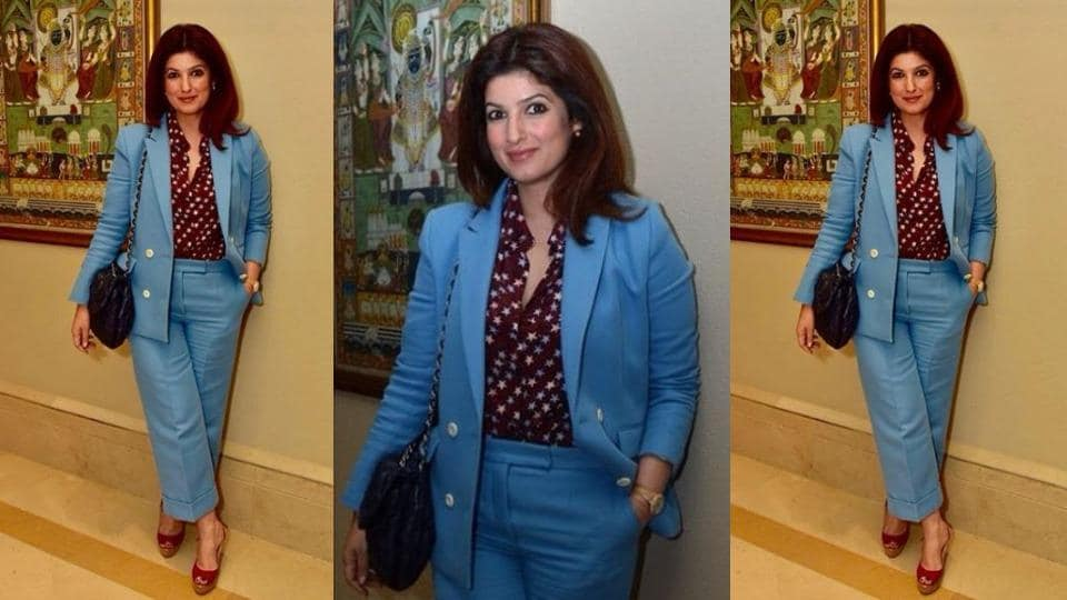 If her monochrome trouser and blazer set wasn't eye-catching enough, the star-print burgundy shirt gave Twinkle Khanna's look an unexpected pop of colour.
