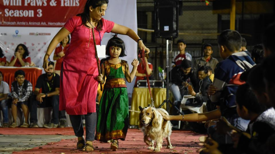 The ramp walk was the highlight of the event with the audience cheering each and every dog and its owner. (Sanket Wankhade/HT PHOTO)