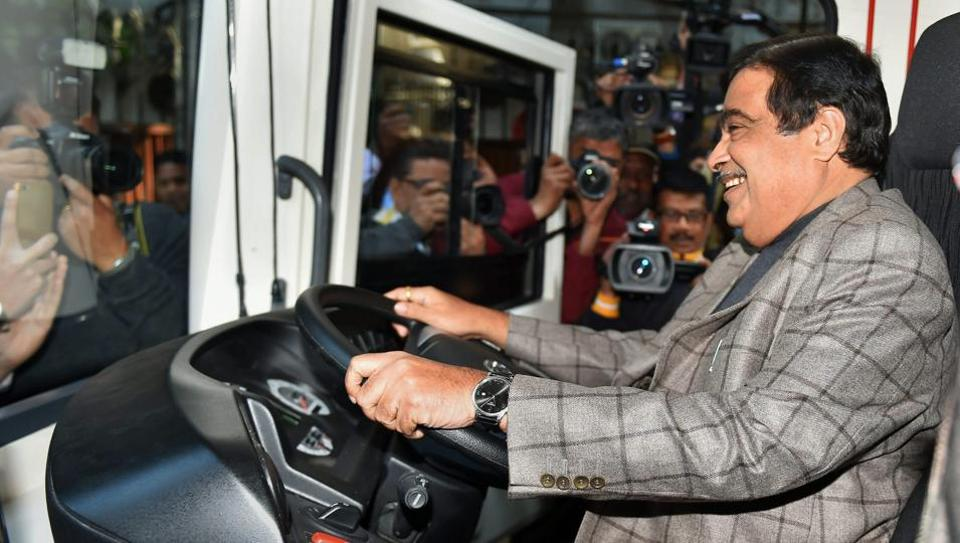 Union minister Nitin Gadkari sits on the driving seat of an electric vehicle during the inauguration of two Electric Vehicle charging points at Niti Aayog in New Delhi on Thursday