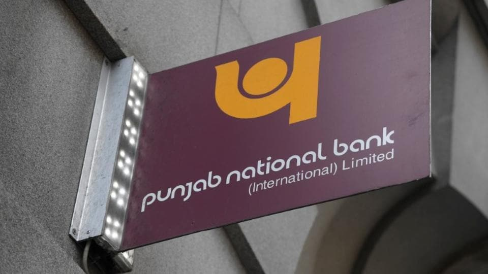 The logo of Punjab National Bank is seen outside a branch of the bank.