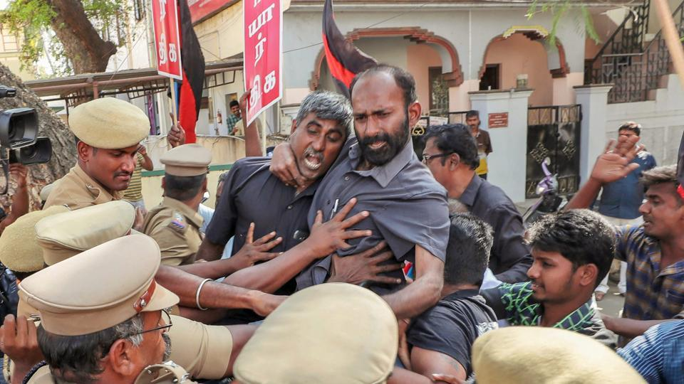 Police try to detain members of Thanthai Periyar Dravida Kalagham protesting against the Supreme Court's verdict on the Cauvery river dispute, in Coimbatore on Friday.
