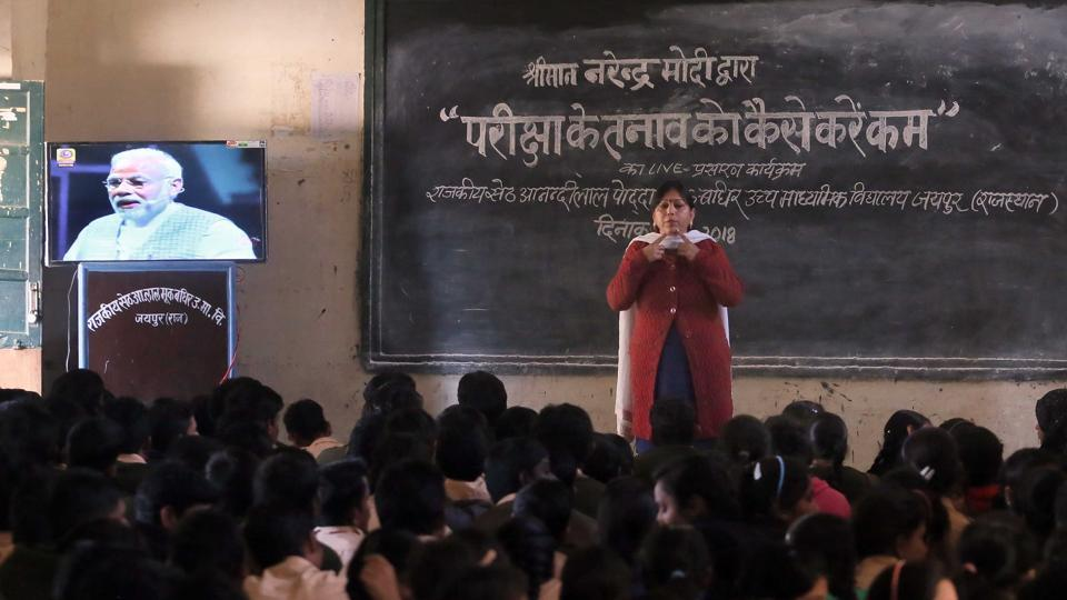 Hearing impaired students at the Seth Anandilal Poddar Deaf And Dumb School in Jaipur watch a telecast of Prime Minister Narendra Modi's talk with students over exam-related stress