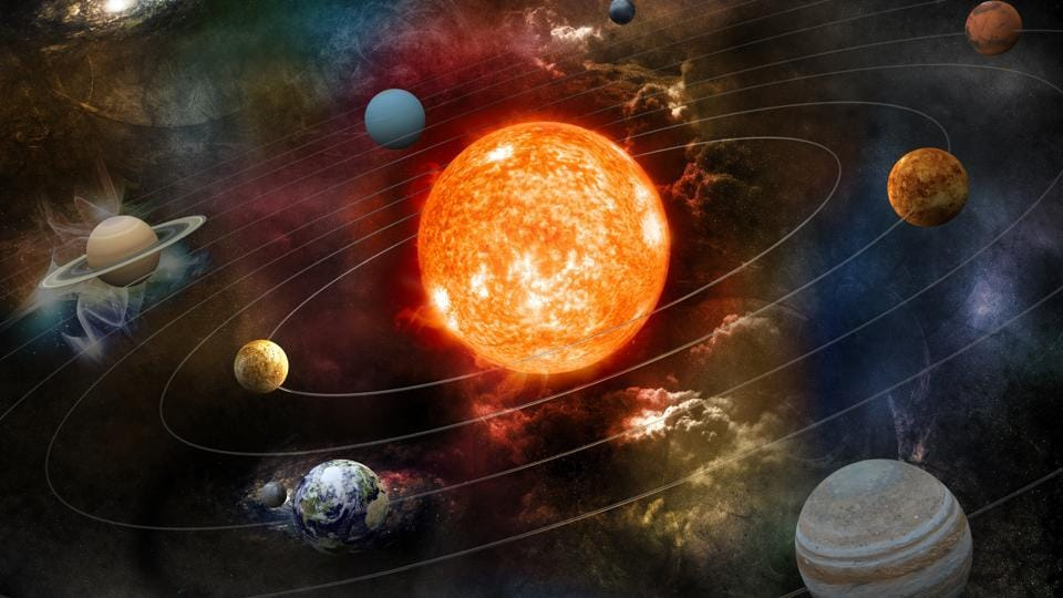 A representation of the sun and the planets of our system orbiting around it.