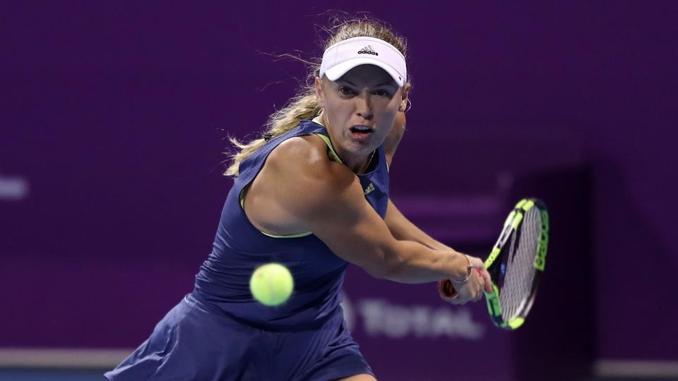 Caroline Wozniacki of Denmark returns the ball to Carina Witthöft of Germany (unseen) during their singles second match at the 2018 WTA Qatar Open in the capital Doha on Thursday.