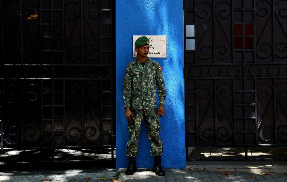 A Maldives soldier stands guard outside the president's residence in Male.