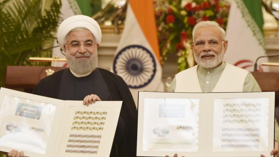 Prime Minister Narendra Modi releasing a commemorative stamp with Iranian President Hassan Rouhani at Hyderabad House in New Delhi on Saturday.