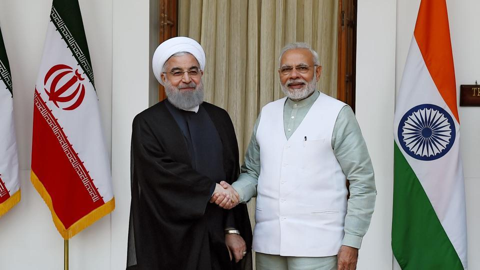 Iranian President Hassan Rouhani (L) shake hands with Indian Prime Minister Narendra Modi before a meeting at Hyderabad house in New Delhi on February 17, 2018.
