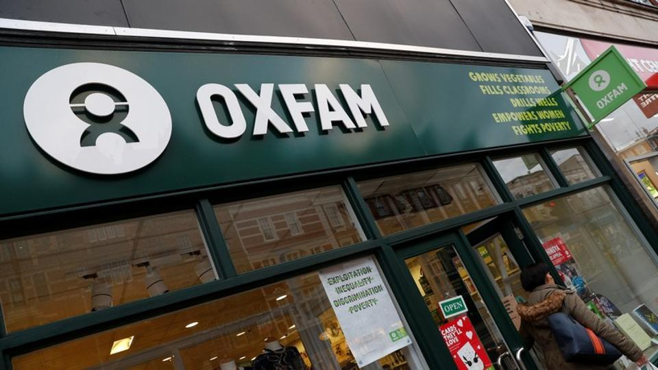 A sign is seen above a branch of Oxfam in London, Britain.