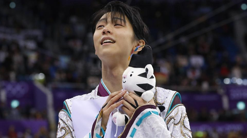 Yuzuru Hanyu of Japan celebrates after winning the gold medal at the 2018 Winter Olympics on Saturday.