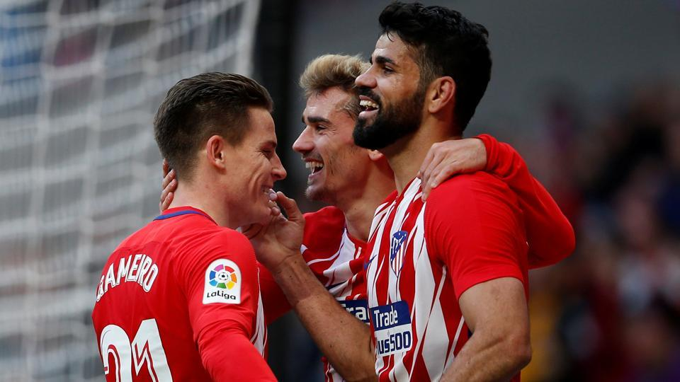 Atletico Madrid's Diego Costa celebrates scoring their second goal with Antoine Griezmann and Kevin Gameiro during the La Liga match vs Athletic Bilbao on Sunday.