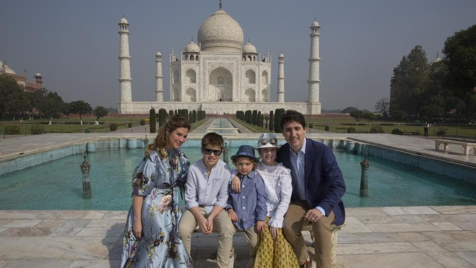 Canadian Prime Minister Justin Trudeau, his wife, Sophie Gregoire Trudeau, their sons Hadrien and Xavier, daughter Ella-Grace, second right, pose for the photographs in front of Taj Mahal, in Agra, India, Sunday, Feb. 18, 2018.