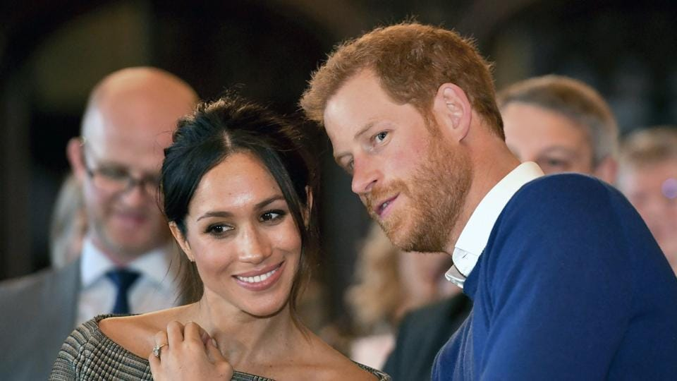 Britain's Prince Harry talks to Meghan Markle as they watch a dance performance by Jukebox Collective in the banqueting hall during a visit to Cardiff Castle, Wales. With Prince Harry and Meghan Markle's May 19 wedding fast approaching, the fashion and bridal worlds are abuzz with talk of who the bride will pick to design her dress and what kind of look she would go for.
