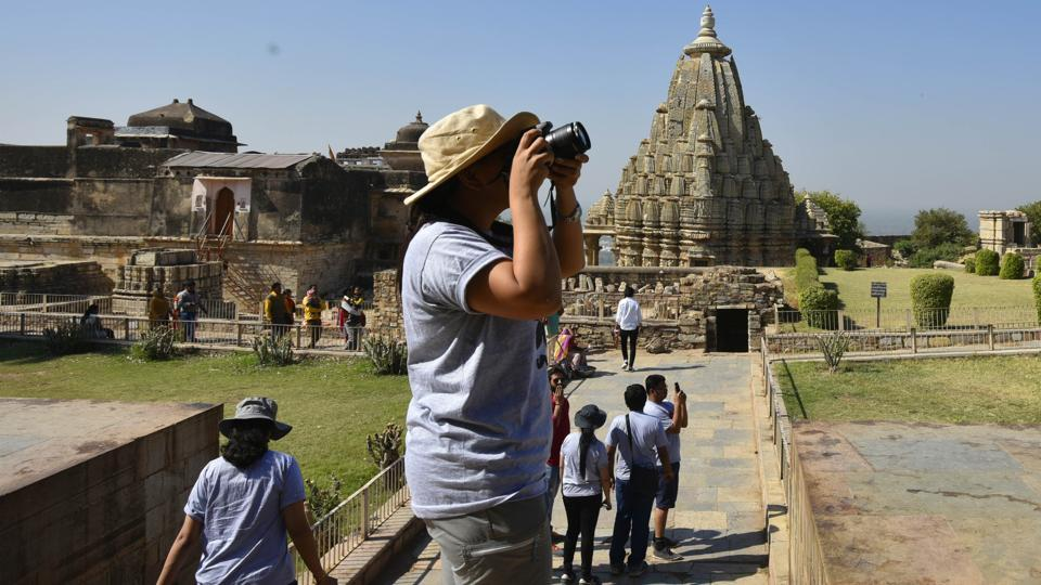 A tourist inside the Chittorgarh Mahal complex in Rajasthan. Both the fort and the town of Chittorgarh have memorials to the jauhars committed by the women in the past. Inside the fort is a Jauhar Sthal, where locals believe the last of the three jauhars had taken place.  (Raj K Raj /HT Photo)