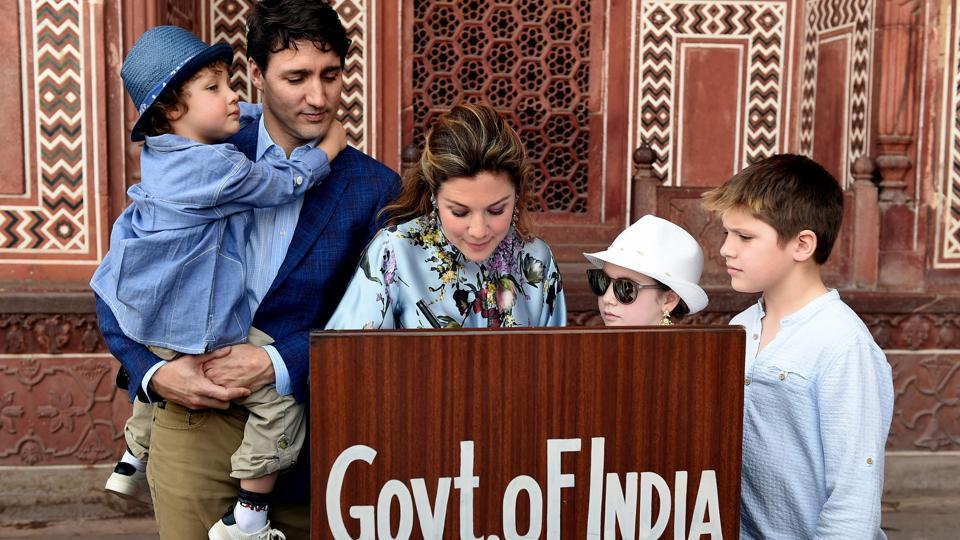 Prime Minister of Canada Justin Trudeau, his wife Sophie Gregoire and their children write on the visitors book during their visit to Taj Mahal in Agra. (Money Sharma / AFP)
