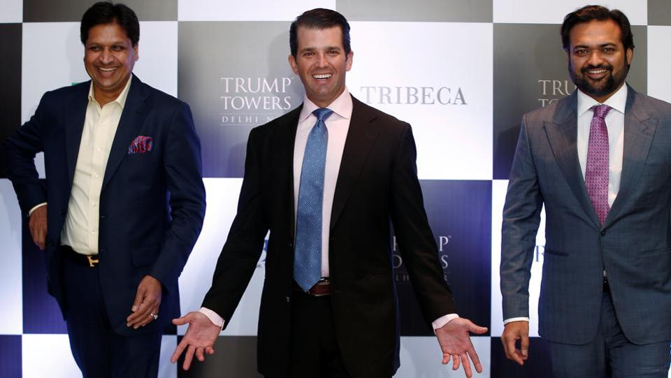 "Donald Trump Jr. gestures as Basant Bansal, Chairman and Managing Director of M3M India and Kalpesh Mehta, founder of Tribeca Developers, look on during a photo-op, before a meeting in New Delhi. Trump, said on Tuesday India is ""substantially above board"" for business compared to China, and reforms underway will help attract investments to Asia's third largest economy from countries like US. (Adnan Abidi / REUTERS)"