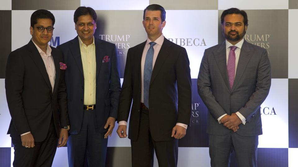 The eldest son of US President Donald Trump, Donald Trump Jr., second from right, poses with promoters of Trump Towers Pankaj Bansal, left, Basant Bansal of M3M developers and Kalpesh Mehta, right, of Tribeca developers at a photocall in New Delhi.
