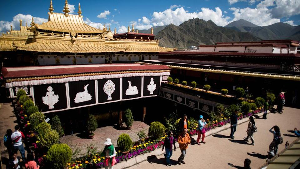 Tourists on the roof of the Jokhang Temple in the regional capital Lhasa, in China's Tibet Autonomous Region.