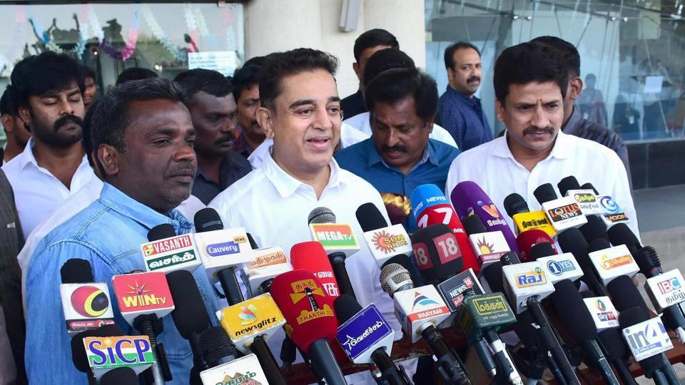Actor Kamal Haasan addresses the media at the airport in Madurai on Tuesday, a day before he is set to launch his political party.