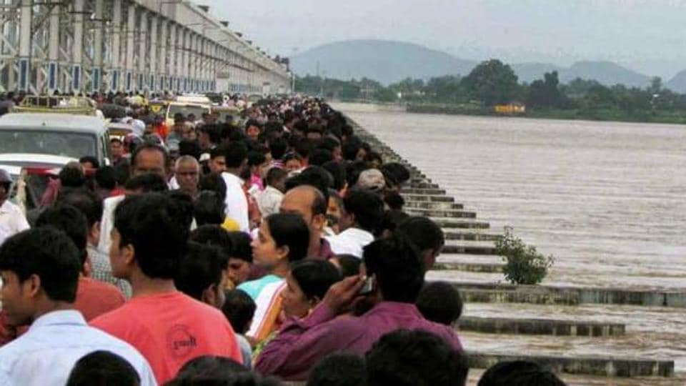 People watch the Mahanadi river flowing above the danger mark near Mundali in Cuttack. The Odisha government had moved the court in December, 2016, seeking an order, asking Chhattisgarh to stop its construction work in projects on the upstream of Mahanadi, saying it had affected the river flow in the state.