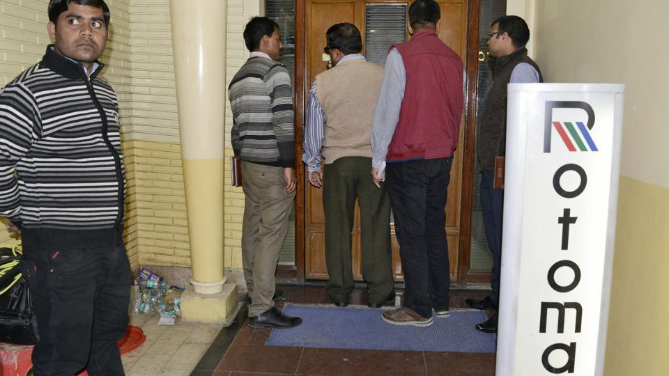 CBI officials at the Rotomac Global Private Limited office at Mall Road in Kanpur on Monday.