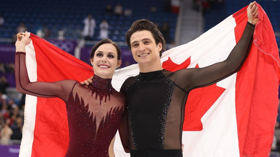 Tessa Virtue and Scott Moir of Canada celebrate after winning the gold medal at the Pyeongchang 2018 Olympics.