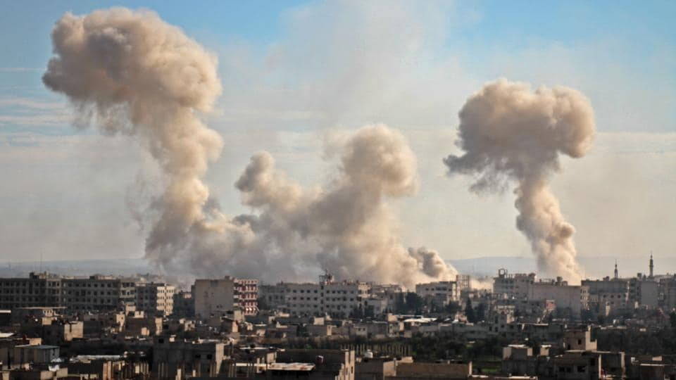 Smoke rises from buildings following bombardment on the village of Mesraba in the rebel-held besieged region of Eastern Ghouta on the outskirts of the capital Damascus. According to the Syrian Observatory for Human Rights (SOHR), at least 250 civilians have been killed by shelling and air strikes in last two days.  (Hamza Al-Ajweh / AFP)