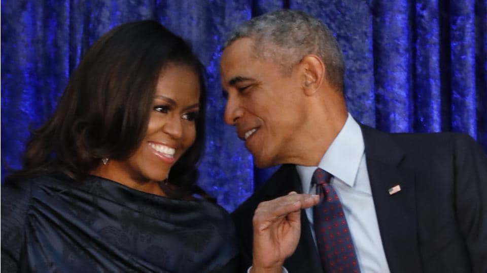 Former US President Barack Obama sits with former first lady Michelle Obama prior to the unveiling of their portraits at the Smithsonian's National Portrait Gallery in Washington.