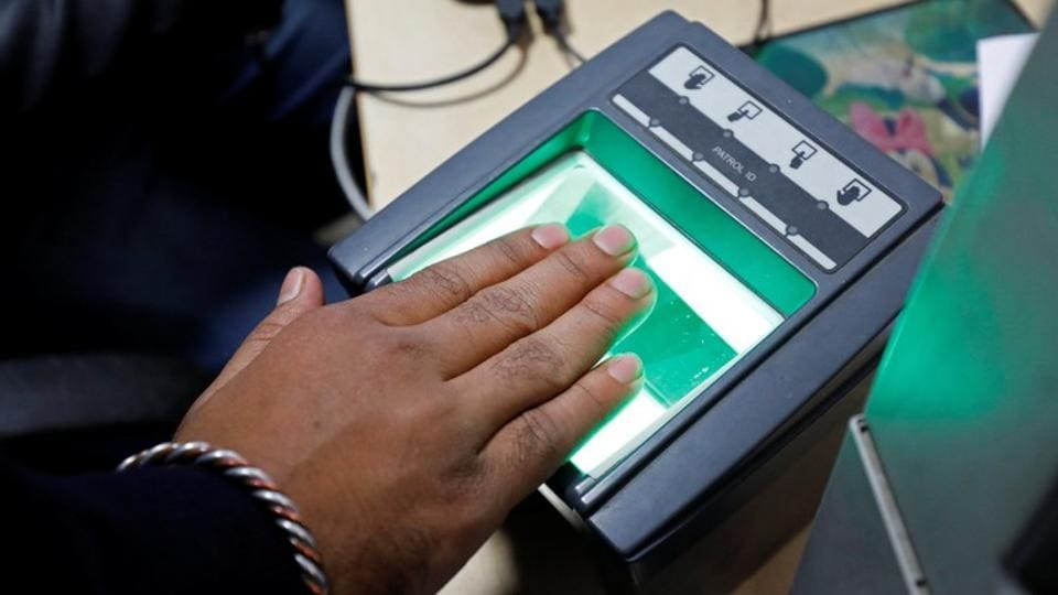 A woman goes through the process of finger scanning for the Unique Identification (UID) database system, at a registration centre in New Delhi.