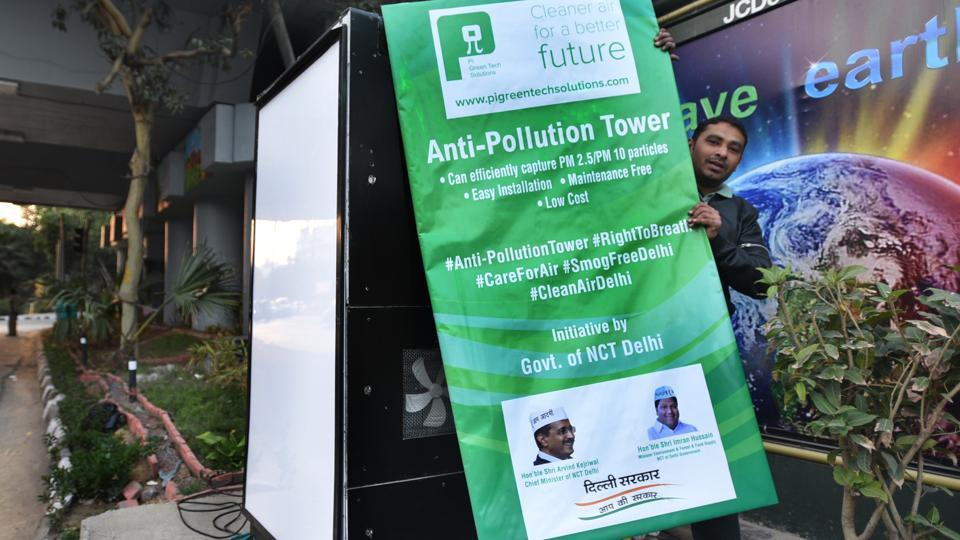 A man installs an Anti-Pollution tower, an initiative by Delhi government for cleaner air at ITO in New Delhi on February 16.