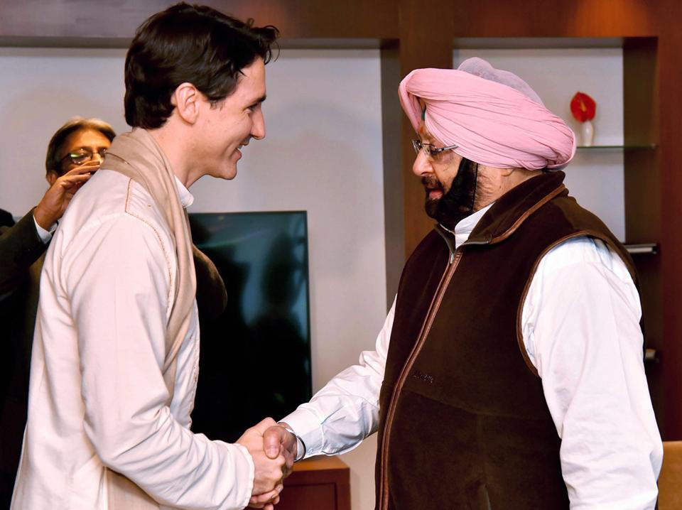 Canadian Prime Minister Justin Trudeau shakes hands with Punjab Chief Minister Amarinder Singh in Amritsar on February 21, 2018.