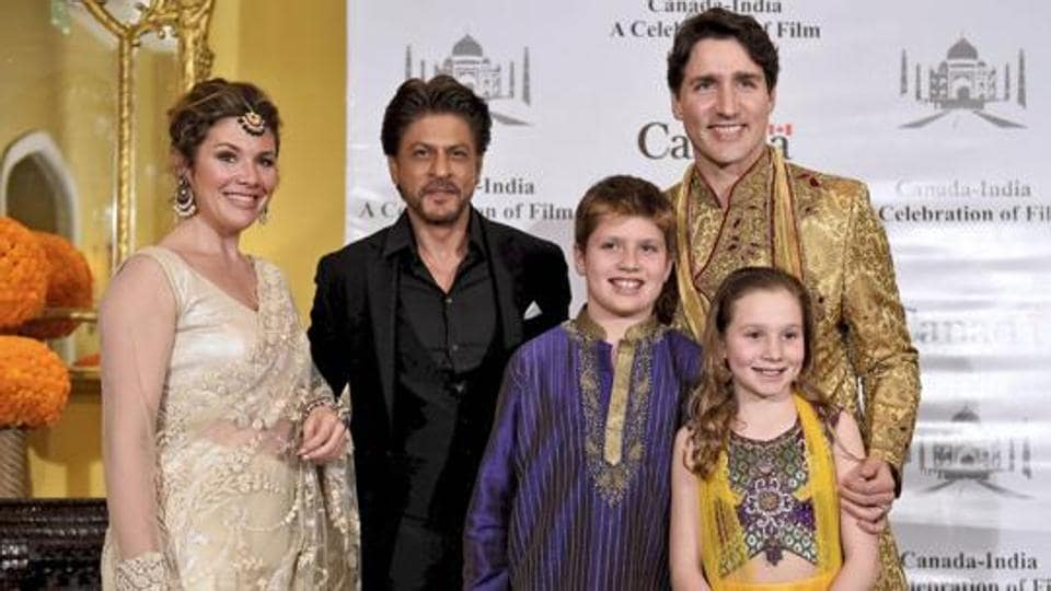 Canadian Prime Minister Justin Trudeau, his wife Sophie Grégoire, daughter Ella-Grace Margaret, son Xavier James pose for a photograph with Shah Rukh Khan in Mumbai on Tuesday.