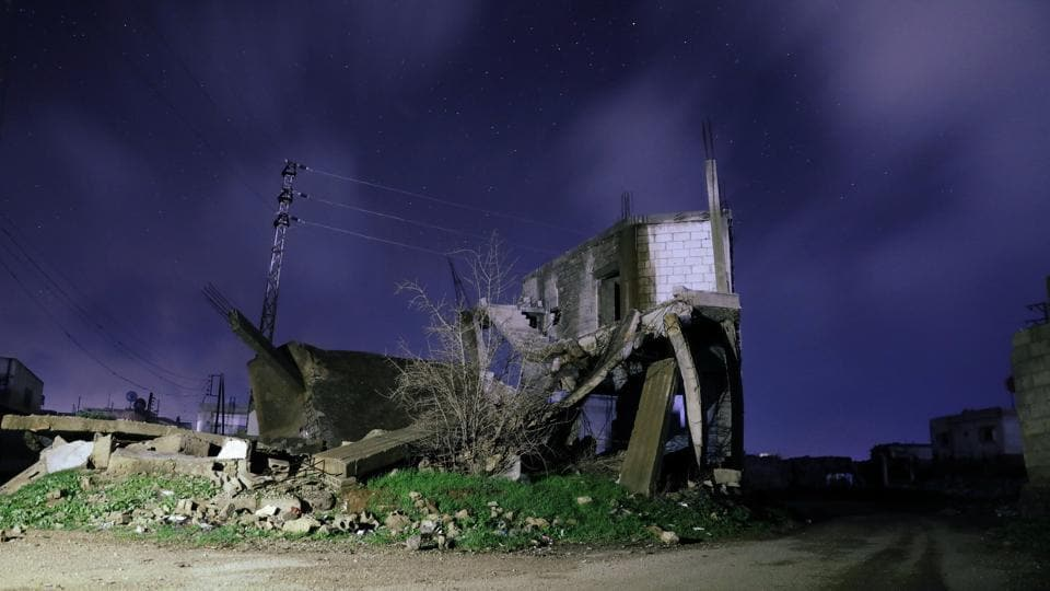 Damaged houses are pictured at night in Daraa, Syria. Held by rebels since 2012, Eastern Ghouta is the last opposition pocket around Damascus and President Bashar al-Assad is keen to retake it with an apparently imminent ground assault. (Alaa Al-Faqir / REUTERS)
