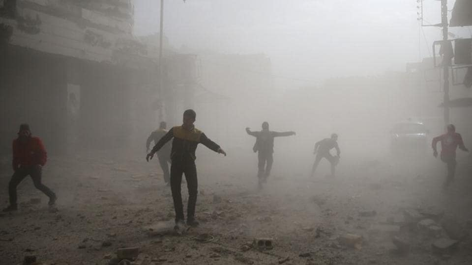 "Civil defence members and civilians are seen running after an air raid, outside of Damascus. The bloodshed prompted the UN children's agency UNICEF to issue a largely blank statement on Tuesday saying  ""we no longer have the words to describe children's suffering."" (Bassam Khabieh / REUTERS)"