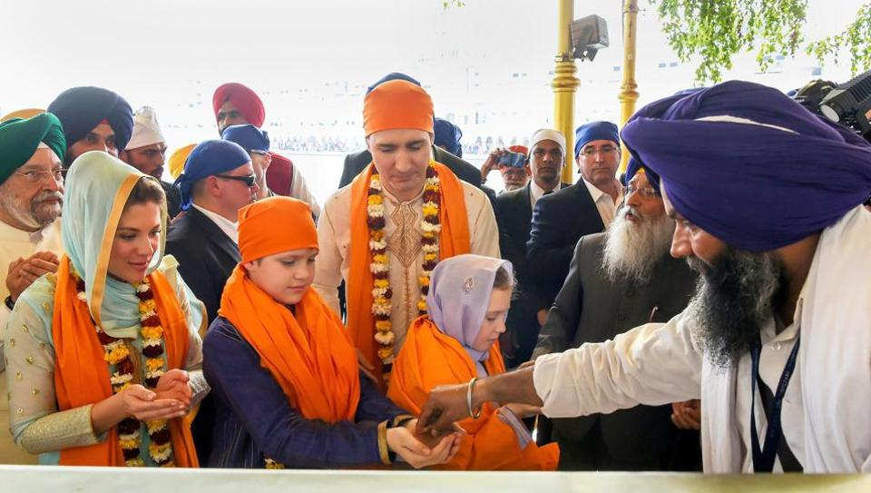 Canadian Prime Minister Justin Trudeau along with his family members receive karah prasad at Golden Temple in Amritsar on Wednesday. (PTI)