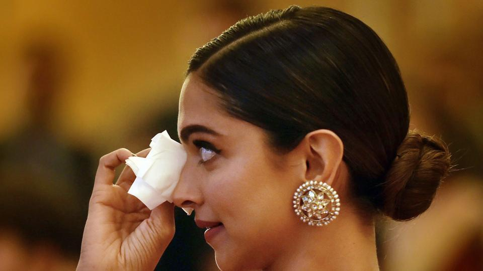 Deepika Padukone gets emotional during presentation of BAI's Lifetime Achievement Award to her father Prakash Padukone at a function in New Delhi.