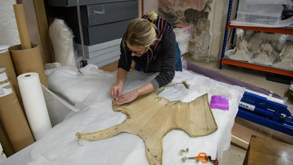 Among the details discovered during conservation work is that the boning finishes slightly lower on the right-hand side, allowing right-handed Elizabeth greater ease of movement. (Leon Neal / Getty Images)