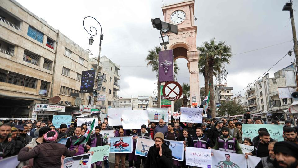 Syrians gather in solidarity in the rebel-held enclave of Eastern Ghouta during a demonstration in Idlib against the government bombardments. As per monitoring group, SOHR-- the death toll was likely to increase and the highest since the alleged chemical attack in the same region in 2013, which activists say claimed around 1,400 lives. (Omar Haj Kadour / AFP)