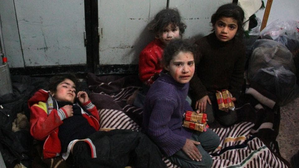 Syrian children seen at a makeshift hospital in Douma following air strikes on the Syrian village of Mesraba. Doctors have been working round the clock to treat hundreds of injured people, even though medical supplies and facilities were in short supply. (Hamza Al-Ajweh / AFP)
