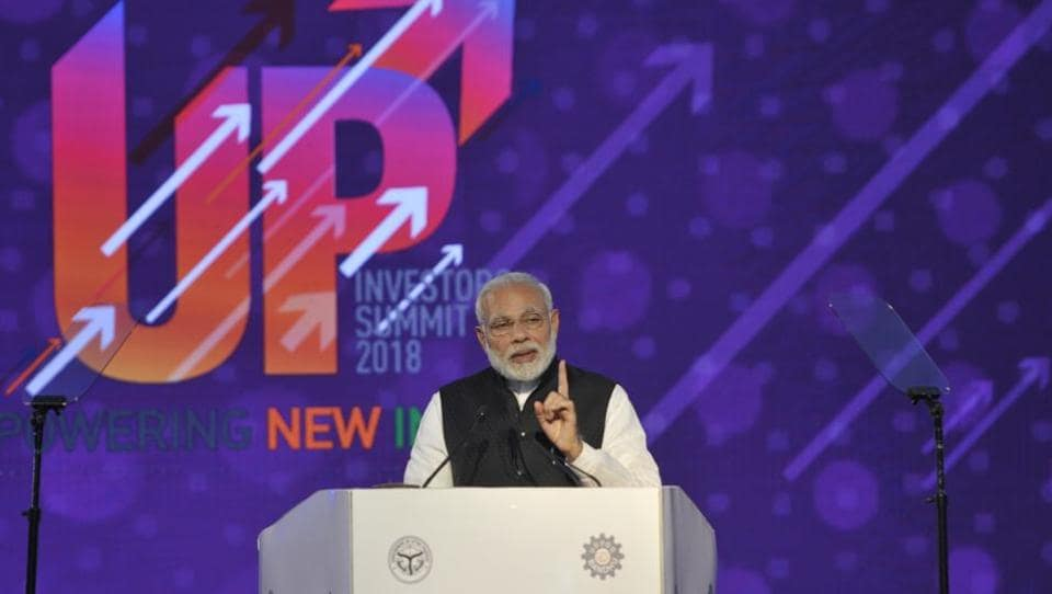 PM Narendra Modi announced on Wednesday a defence industrial corridor in the Bundelkhand region to bring development in one of the most backward regions of Uttar Pradesh. Terming holding of investor's summit in UP and congregation of industrialists from all over as a sign of a big change, Modi said the Yogi government has overcome the previous negativity and shown a ray of hope to people with positive changes. (Deepak Gupta / HT Photo)