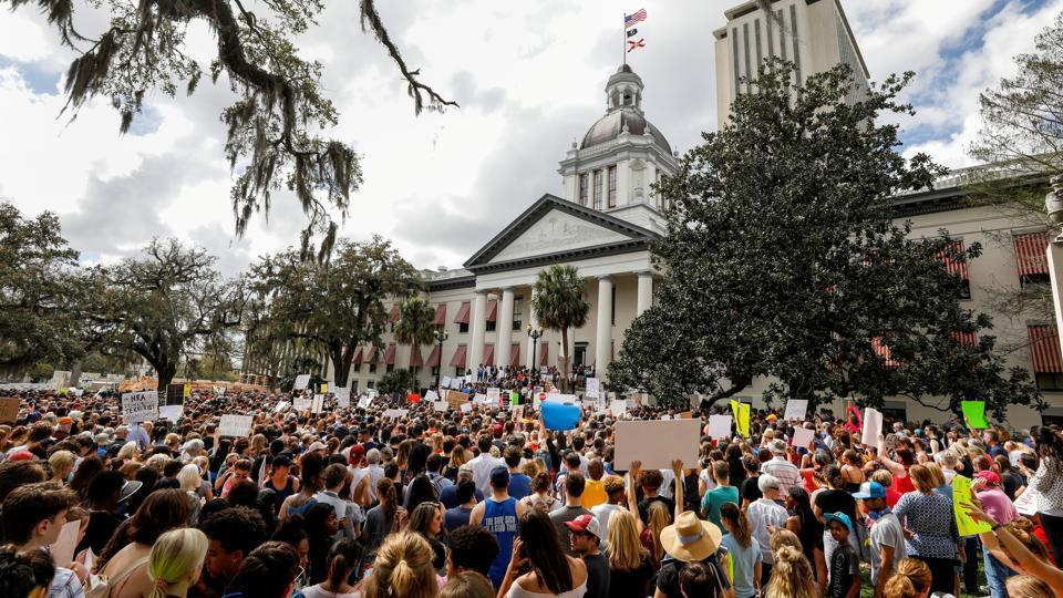 Protestors rally outside the Capitol urge Florida lawmakers to reform gun laws in Tallahassee. A week after a shooter murdered 17 people in a Florida high school, thousands of protesters, including many angry teenagers, swarmed into the state Capitol on Wednesday, calling for changes to gun laws, a ban on assault-type weapons and improved care for the mentally ill. (Colin Hackley / REUTERS)