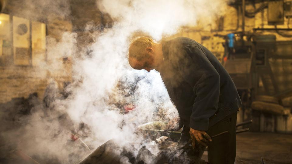 Stringer is seen steaming moulds in the factory. The collection features pieces created from solid polished brass and traditional cast iron, as well as contemporary bright chrome and ceramic designs. (Christopher Furlong / Getty Images)
