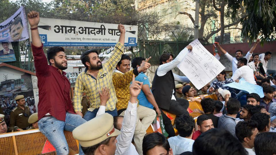 New Delhi: Indian Youth Congress activists shouts protest against Delhi Chief Minister Arvind Kejriwal in New Delhi on Wednesday.