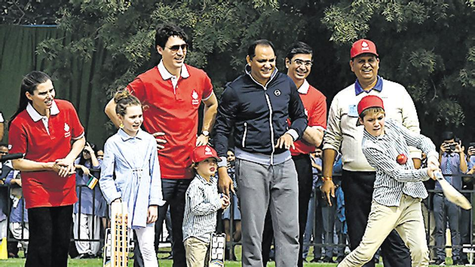 Canadian Prime Minister Justin Trudeau, second left, his son Hadrien, daughter Ella-Grace, left, and former Indian cricket team captain Mohammad Azharuddin look on as the Canadian leader's other son Xavier plays a cricket shot, in New Delhi on February 22, 2018.