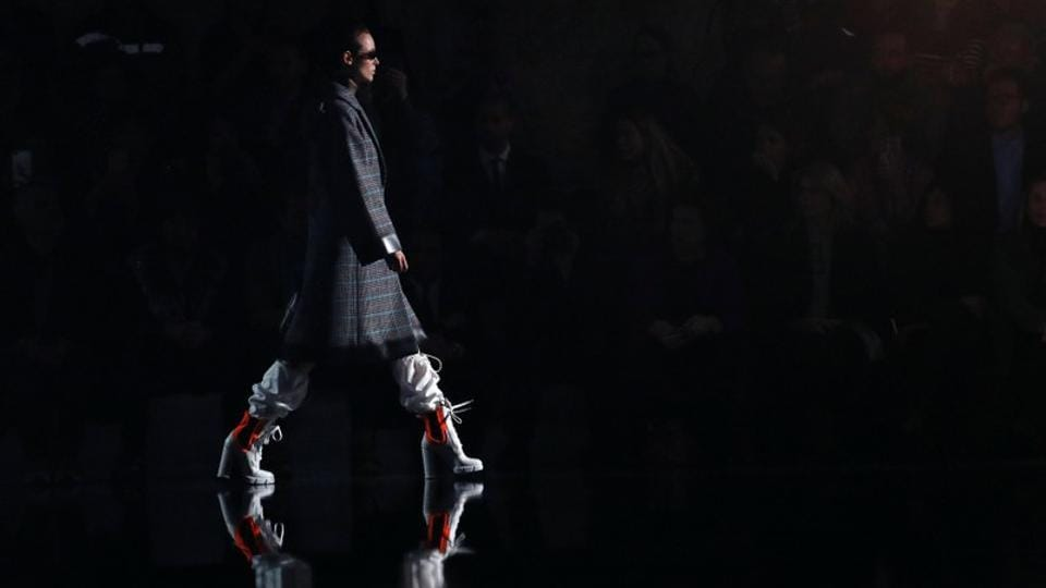 A model presents a creation from the Prada Autumn/Winter 2018 women collection during the Milan Fashion Week.  (Alessandro Garofalo / REUTERS)