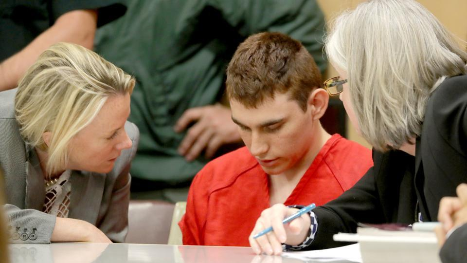 Nikolas Cruz, facing 17 charges of premeditated murder in the mass shooting at Marjory Stoneman Douglas High School in Parkland, appears in court for a status hearing in Florida on February 19. (Mike Stocker / REUTERS)