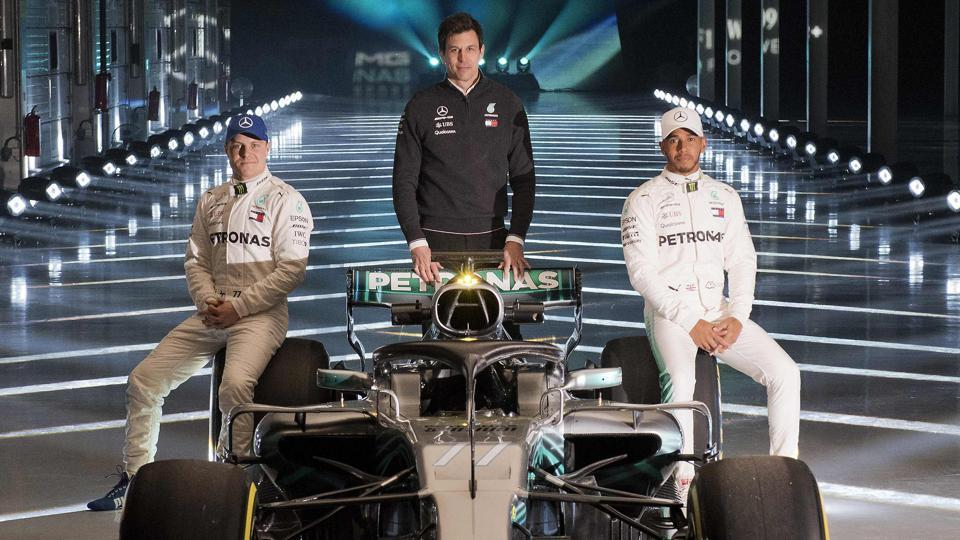 Mercedes F1 team drivers  Valtteri Bottas (L) and Lewis Hamilton (R), with Mercedes AMG Petronas Formula One Team Principal and Executive Director, Toto Wolff (C) pose on the new 2018 season Mercedes-AMG F1 W09 EQ car during its launch at Silverstone, near Towcester, central England on Thursday.