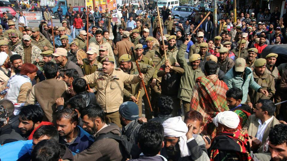 Police trying to control a group of people protesting the rape and murder of an eight-year-old girl in Kathua, Jammu, January 30