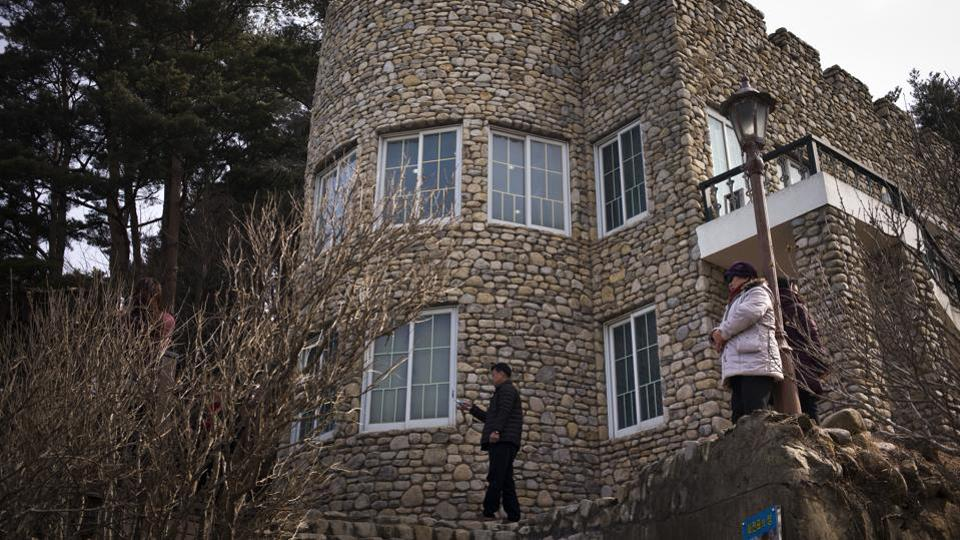 Visitors stand outside the Hwajinpo Castle which was once a holiday home for late North Korea founder Kim Il Sung in South Korea. It belonged to North Korean territory before the 1950-53 war, but eventually wound up in South Korea after the border was redrawn.  (Jae C. Hong / AP)
