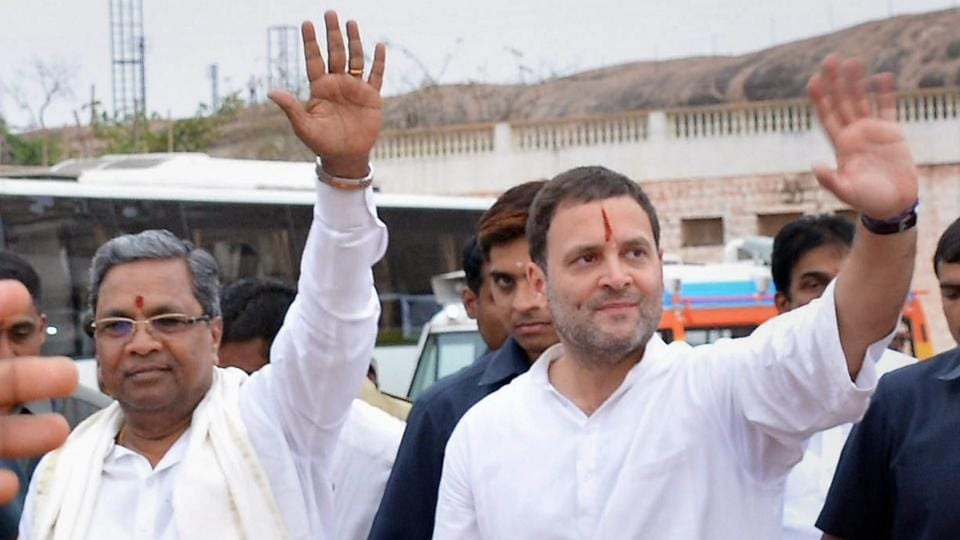 Congress president Rahul Gandhi and Karnataka CM Siddaramaiah wave to people during a rally in Koppal.